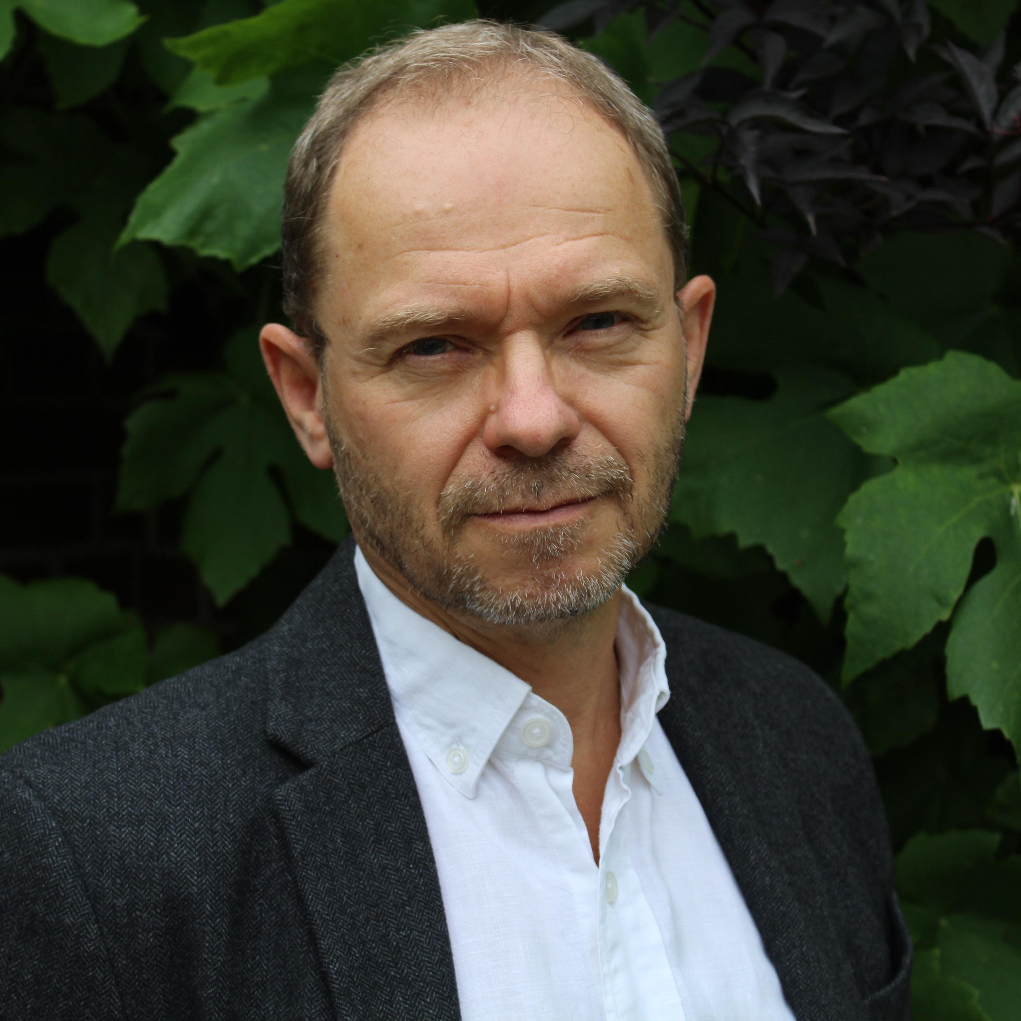 Portræt Af Klaus E. Olsen